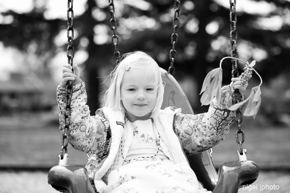 candid-six-year-old-blonde-girl-swing-set-seattle.jpg