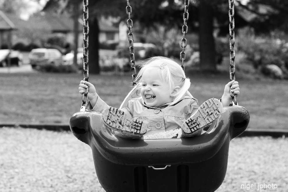 candid-three-year-old-blonde-girl-swing-set-seattle.jpg