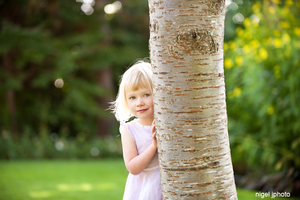 family-portrait-photography-seattle-ballard-four-year-old-girl-behind-tree.jpg