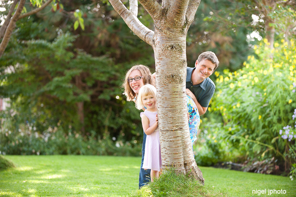 family-portrait-photography-seattle-ballard-locks-young-couple-with-daughter-tree.jpg