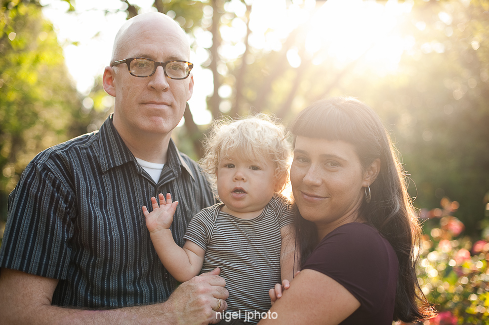 portrait-young-couple-one-year-old-boy-sun-backlit-seattle-3.jpg