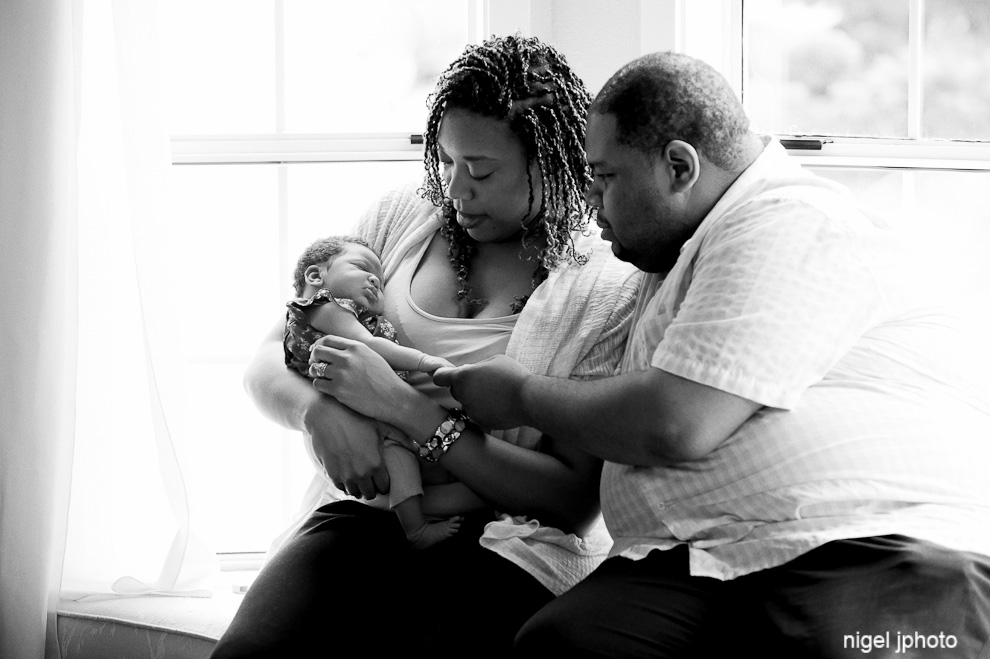 newborn-girl-held-by-new-parents-african-american-seattle-family-photography-2.jpg