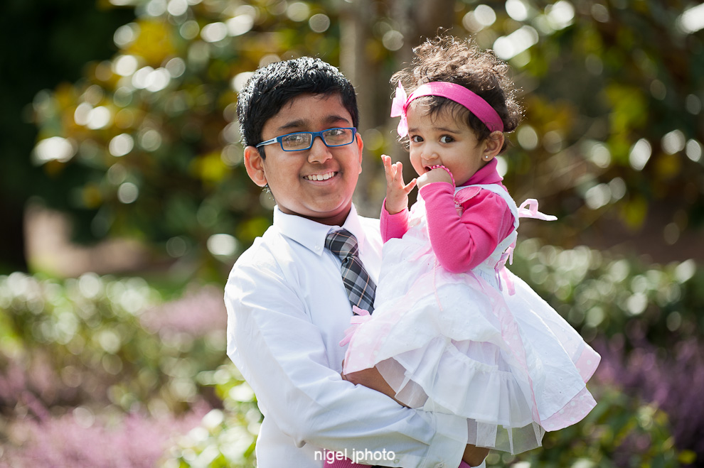 indian-family-brother-holding-baby-sister-downtown-park-bellevue-seattle-family-photography.jpg