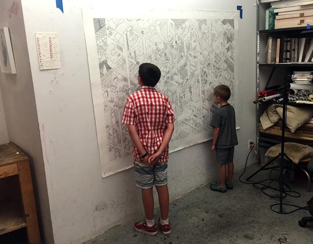 Studio assistants inspecting the first layer of ink on Big School on 7/19/16