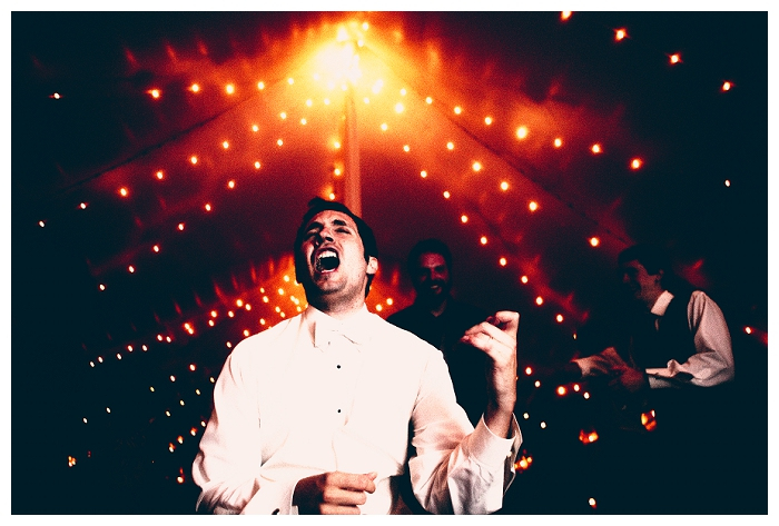 Massachusetts Wedding Photography, groom rocking out at Zukas Hilltop Barn in Spencer MA, creative edgy image