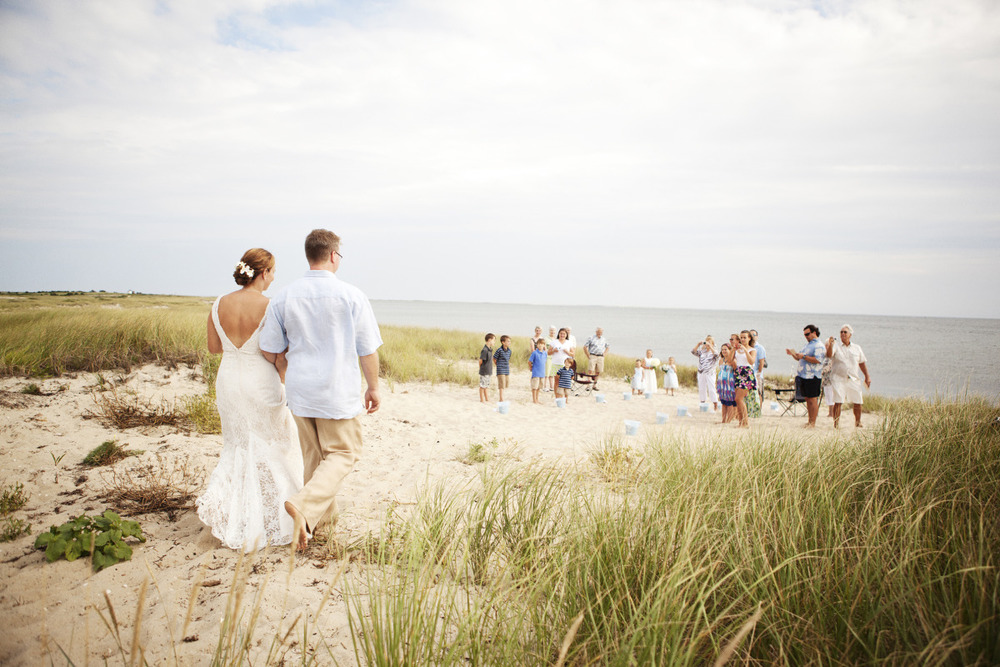 Cape Cod Wedding, bride and groom proceed down the aisle on Harding's Beach in Chatham MA