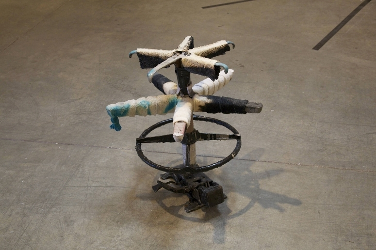 "office chair, shelf brackets, terry cloth arm bands, washi tape, rope, gaffer's tape, mortar, dye, bleach  37"" x 23"" x 23""  Otis College of Art and Design  Bolsky Gallery  Los Angeles, CA"