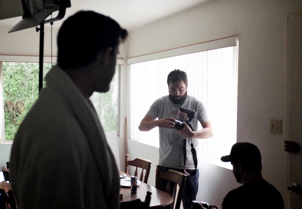 Zach Frankart, director of photography and producer, prepares the camera