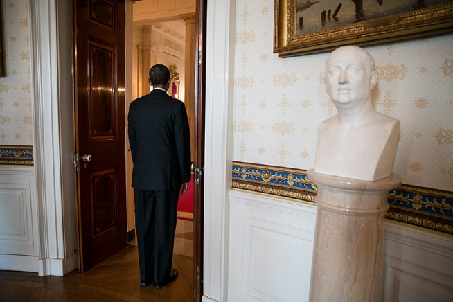 President Barack Obama waits as he is introduced for an event honoring the recipients of the 2011 National Medal of Science and National Medal of Technology and Innovation, in the Blue Room of the White House, Feb. 1, 2013. A bust of Christopher Columbus is seen at right. (Official White House Photo by Pete Souza)