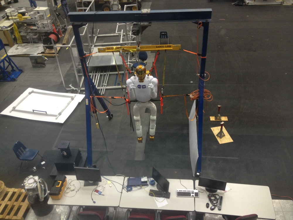 Robonaut is designed to help the astronauts with testing tasks in the space station.  This one's just ... hanging out.