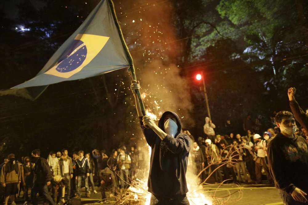 demonstrators-gathered-around-a-burning-barricade-monday-night.jpg