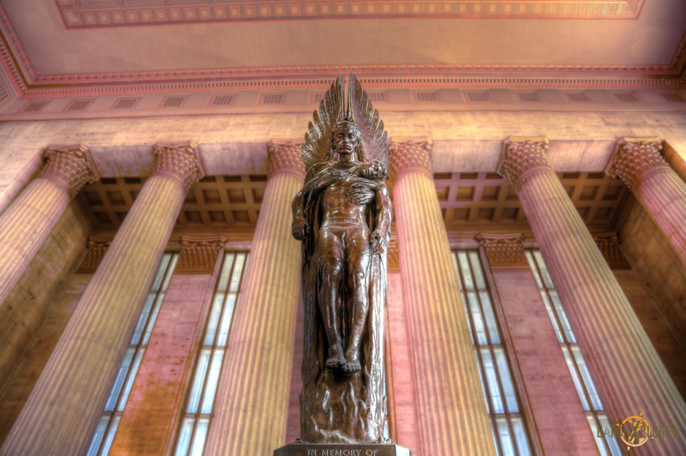 This statue is located near the main entrance of the 30th street Railroad Station in Philadelphia.