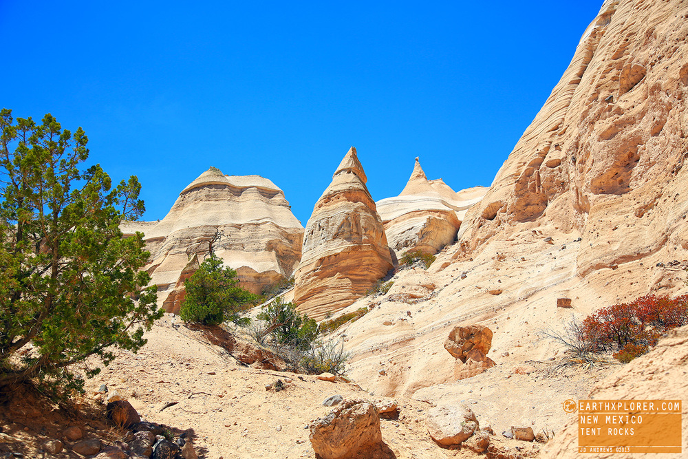 The cone-shaped tent rock formations are the products of volcanic eruptions that occurred 6 to 7 million years ago