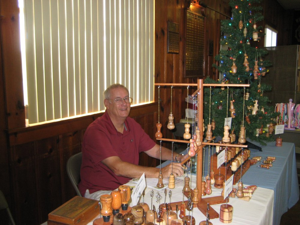 Dave Peterson and his handcrafted wooden bottle stoppers, ornaments, letter openers, etc.