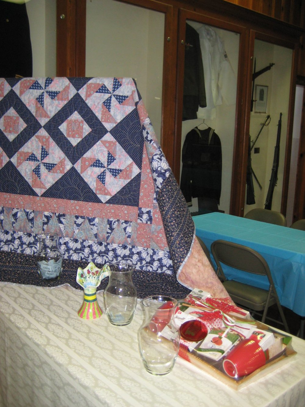 Raffle Items: The quilt was handcrafted and donated by Alice Washburn, Nancie Cameron's sister; the ceramic vase was handcrafted and donated by Teri Nudo; and the Coffee and Tea Gift Basket was donated by Loretta Quigley.