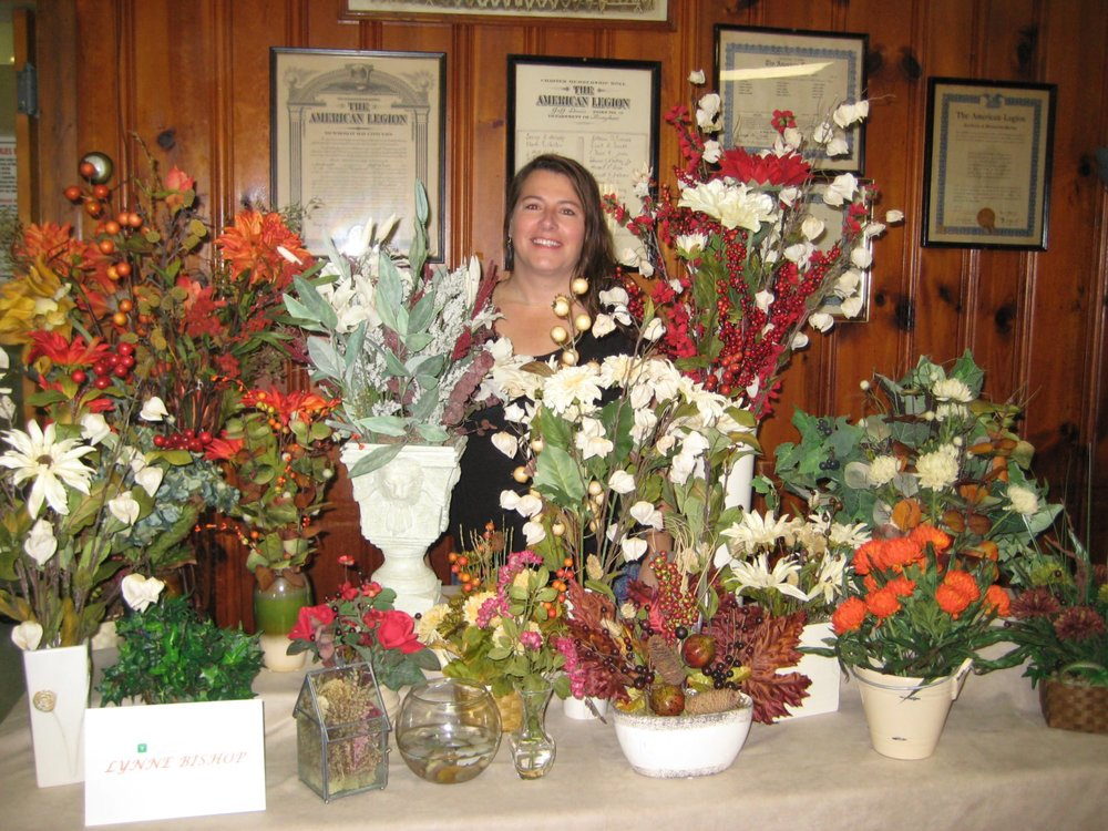 Lynne Bishop shows her beautiful silk flower arrangements.