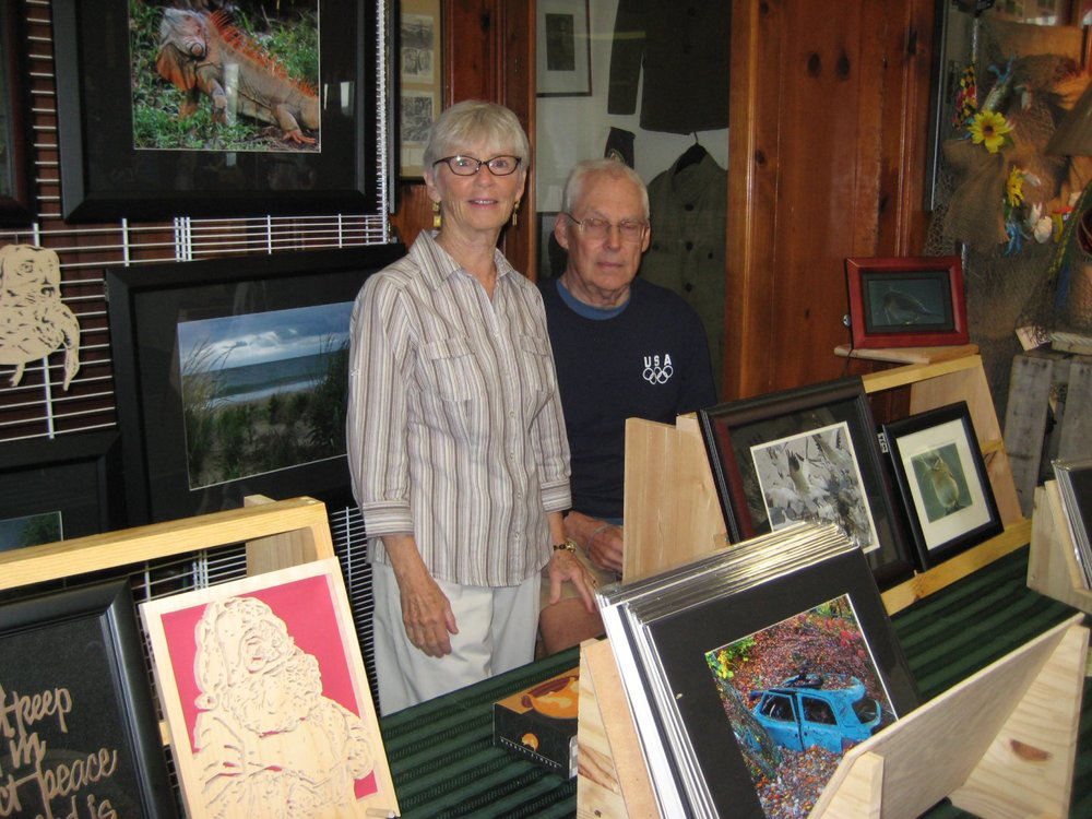 Mary Drake exhibited her wood scroll art, and George Drake exhibited his photography.
