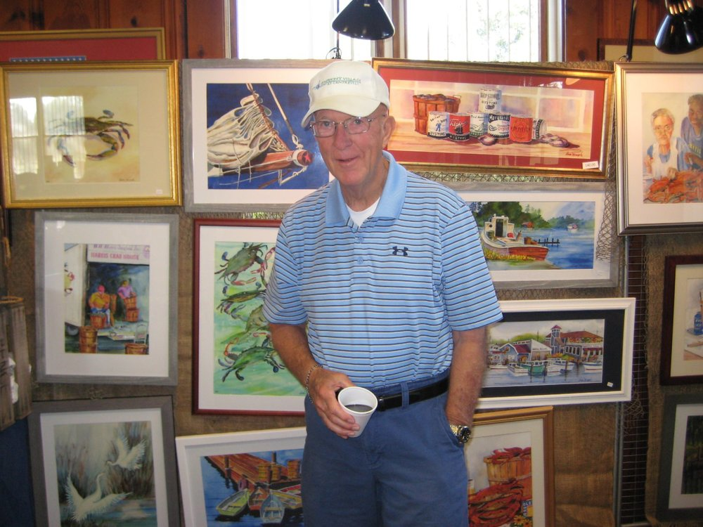 Photographer's Error - I got the wrong guy!  This is Bob Backer standing in front of Dave Murphy's watercolors.