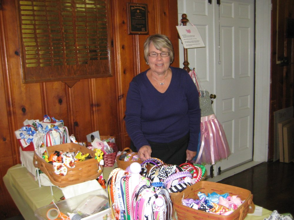 Pat Kindle offered lots and lots of handcrafted children's bows, bow holders, headbands, pony tail holders, flower clips, and more.