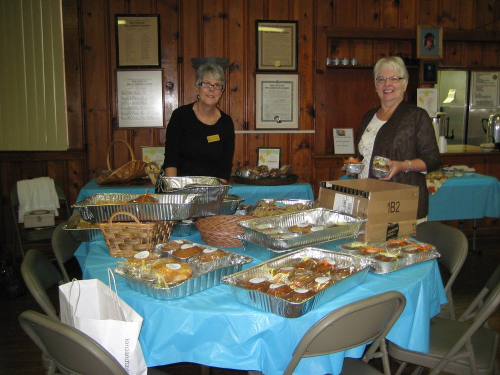 Willie DiLaura and Shirley Clark prepare mini-quick breads for sale and ready the cookies and brownies to be included in the box lunch.