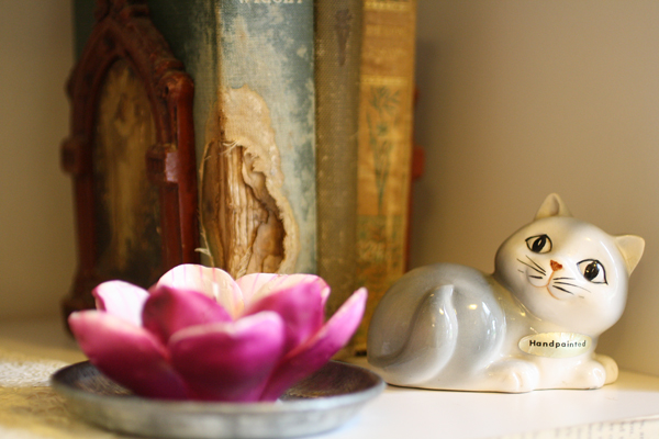 A few vintage finds and delicate flower candle.