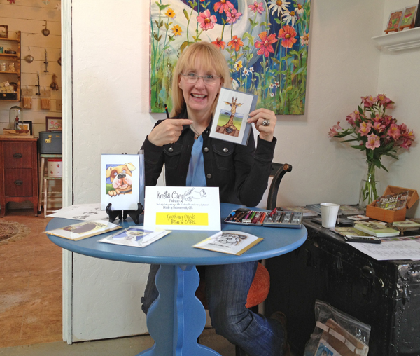 Krista Cary showing her greeting card collection