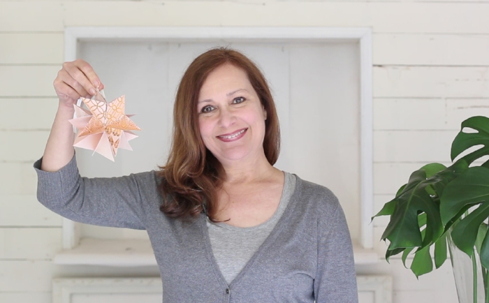 As one of the teachers in the Handcrafted Holidays course, I'll teach you (in a video) how to make this really cute star ornament that folds into a little book.