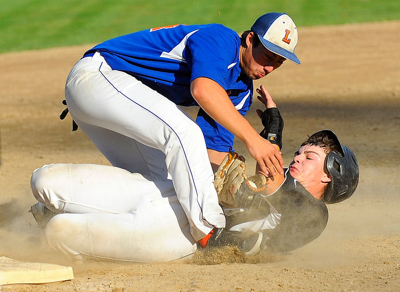 Leominster's Jake Fleming makes the tag for the out on Wachusett's Joe Zottoli as they collide at third base. Leominster won 5-4.