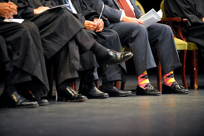 Wearing brightly colored socks, Fitchburg resident Judge Timothy S. Hillman, sits in the Hanover Theatre in Worcester during his oath of office ceremony for his new position as a United States District Court Chief.