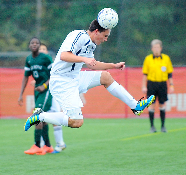 St. Bernard's Joseph McCullough heads away the ball during a game against Oakmont High School.