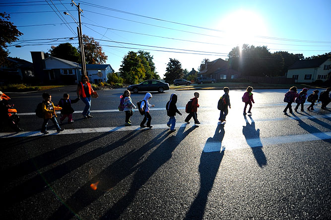 Johnny Appleseed Elementary School students walk along Main Street in Leominster to take part in the International Walk to School Day.