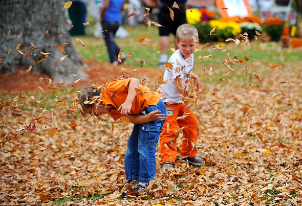 Ashby residents Nicholas East, 5, (near) and Benjamin Johnson, 5, have a playful leave fight.