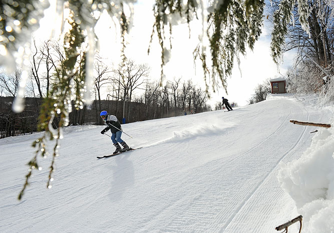 "Skiers make their way down the ""Challenger"" trail during opening day at Wachusett Mountain Ski Area in Princeton."