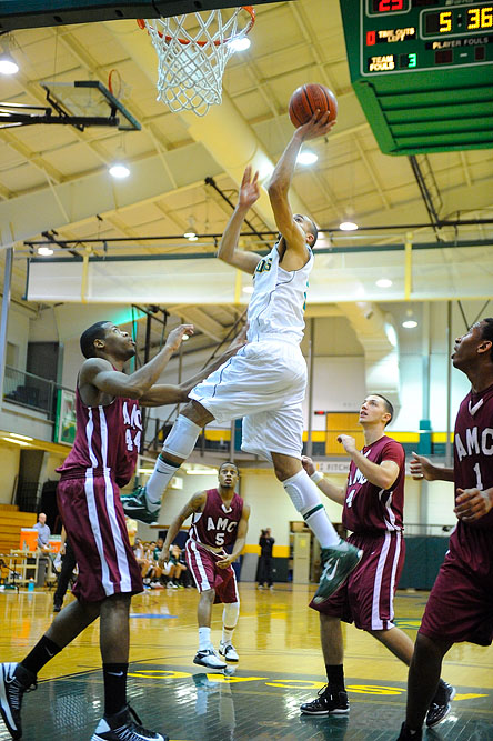 Fitchburg State's Jeremy Kimber lays up the ball off an alley-oop during a game against Anna Maria College.