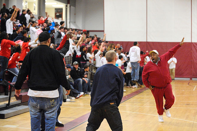 Fans erupt from their seats after a dunk by Fitchburg's Charles Doss during a 66-39 win over rival Leominster High School.