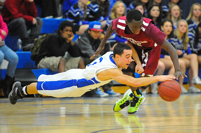 Leominster's Jake Allain and Fitchburg's Manny Payton battle over a loose ball during a game in early February. Fitchburg won 60-55.