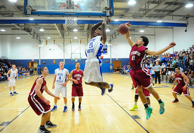 Leominster's Jarell Addo gets blocked by Fitchburg's Jose Hernandez.