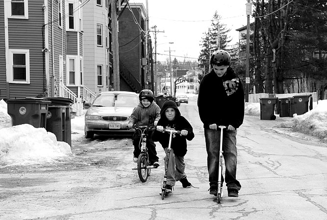 Fitchburg residents, from left, Caleb Colburn, 7, rides his bike as Daniel Cochran, 9, and his step-brother Nathan Cochran, 11, ride their scooters on Beech St. in Fitchburg while enjoying their day off during February vacation.