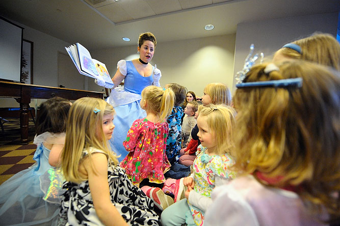 "Erin Conley of Sterling as ""Cinderella"" reads to children at the Thayer Memorial Library in Lancaster, with some kids dressed up in their princess dresses."