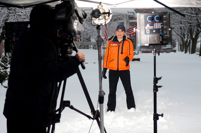 """Good Morning America"" Meteorologist Ginger Zee, filmed by cameraman Tom Fahey, reports the weather live on the Upper Common in Fitchburg for ""ABC World News with Diane Sawyer"", on March 20, 2013 as 12.5 inches of snow fell in Fitchburg and a state-high 14.4 inches in Lunenburg."