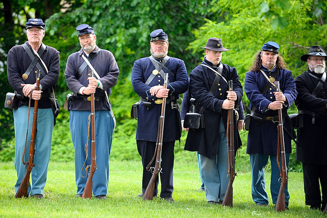Members of the 15th Massachusetts Volunteer Infantry Reenactment Troop look on during the White Cross Twilight Memorial Service at the Leominster Veterans' Center.