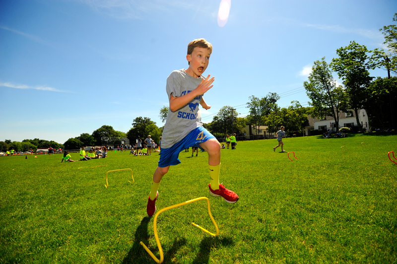 F.A. Cleveland Elementary School 5th-grader Victor Green, 11, participates in a relay race during Physical Education Day at Oldham Elementary School in Norwood. Wicked Local Staff Photo / Brett Crawford