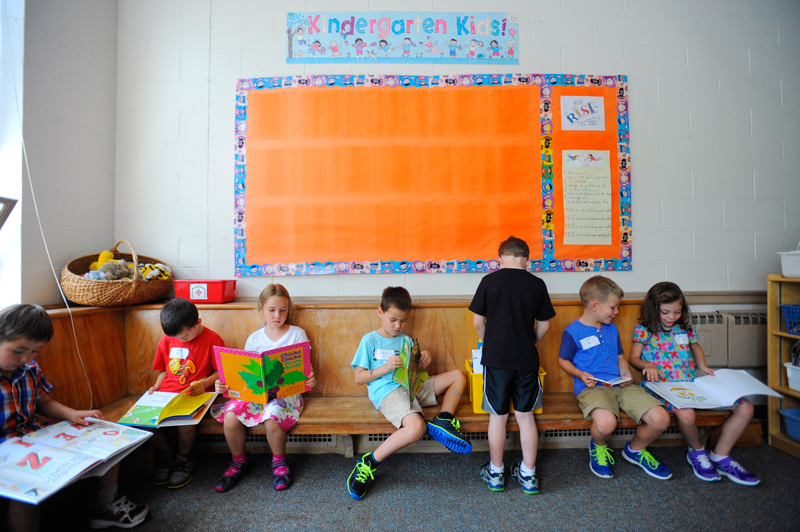 Students read ABC books in Caryn Berkowitz's class on the first day of the new full-day Kindergarten program at the Hardy School in Wellesley on September 2, 2014. (Wicked Local Staff Photo / Brett Crawford)