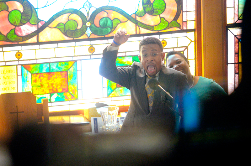 Senior Pastor Brandon Thomas Crowley, seen from the balcony, preaches at the Myrtle Baptist Church on Sunday, September 14, 2014. The church located at 21 Curve St. in Newton, was founded in 1874 by freed slave, Rev. Edmond Kelley. (Wicked Local Staff Photo / Brett Crawford)