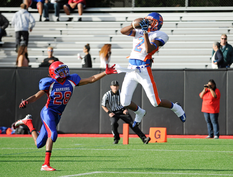 Newton South's Frankie Barros catches a pass by Brookline's Willard Pierre Louis in the end zone for a touchdown during a game on September 14, 2014. (Wicked Local Staff Photo / Brett Crawford)
