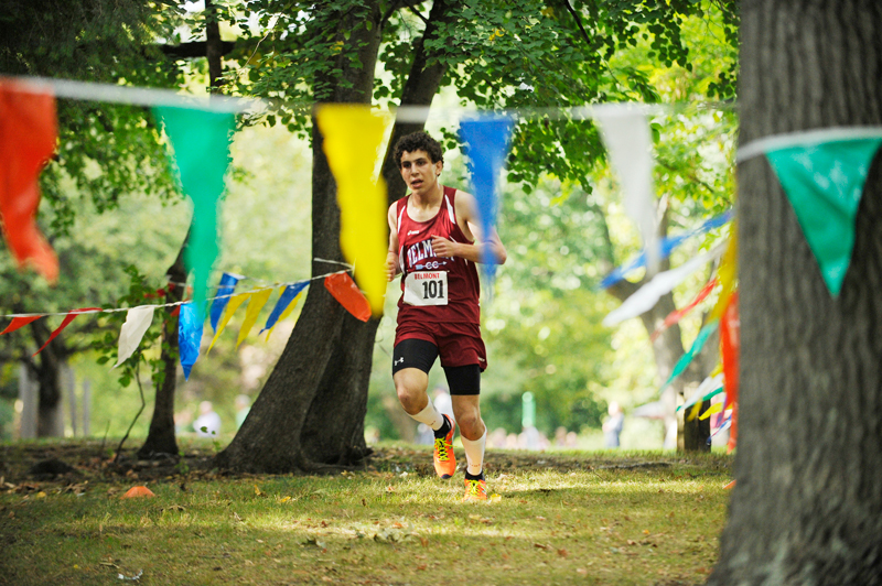 Belmont senior Ari Silverfine runs to a 1st-place finish in a meet against Watertown at Arsenal Park on September 16, 2014. (Wicked Local Staff Photo / Brett Crawford)