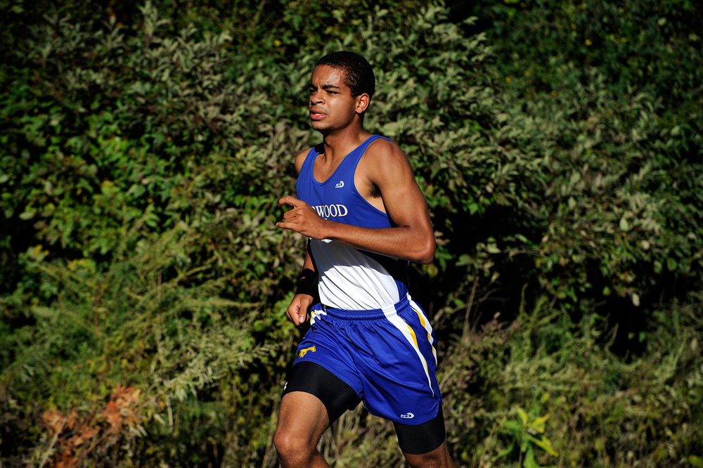 Norwood's Clifton Clark runs in a cross-country meet against Walpole and Brookline on September 23, 2014.