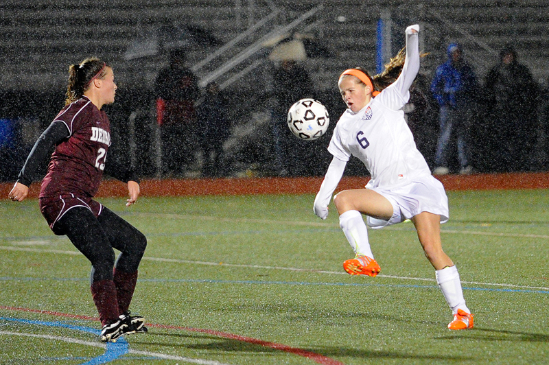Walpole's Libby Foley controls the ball as Dedham's Hannah Ryan closes in during a game on Thursday, Oct. 23, 2014. (Wicked Local Staff Photo / Brett Crawford)