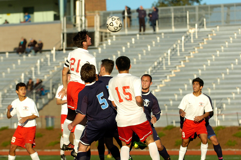 Somerville's Spencer Pitkin (21) heads the ball off a corner-kick during Monday's game against Peabody at Dilboy Stadium, Oct. 27, 2014. (Wicked Local Staff Photo / Brett Crawford)