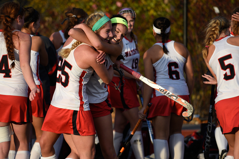 Watertown's Rachel Campbell (left) and Alexandra Doggett celebrate their 4-0 win over Dover-Sherborn in Tuesday's MIAA Division 2 eastern state semifinal game at Reading High School, Nov. 11, 2014. (Wicked Local Staff Photo / Brett Crawford)
